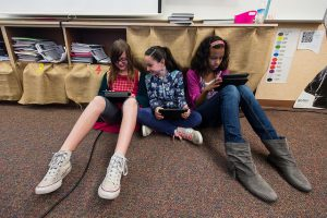 students collaborating on iPads