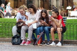 teenage girls on phones