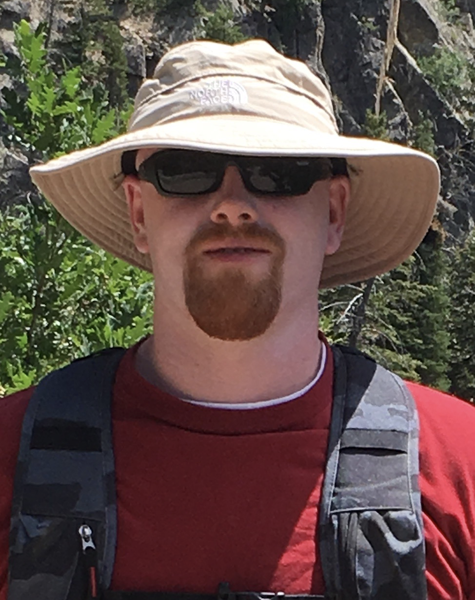 Sean Cartwright  - in floppy hat, shades, and red goatee